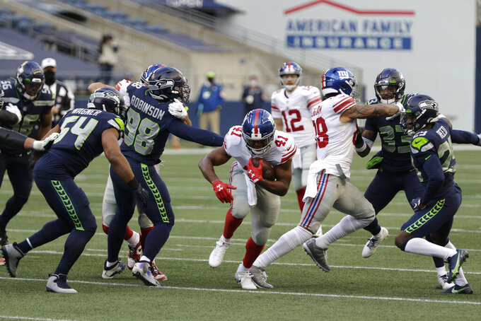 New York Giants running back Alfred Morris rushes against the Seattle Seahawks during the second half of an NFL football game, Sunday, Dec. 6, 2020, in Seattle. (AP Photo/Larry Maurer)