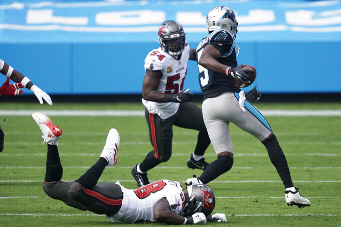 Tampa Bay Buccaneers outside linebacker Shaquil Barrett (58) misses Carolina Panthers quarterback Teddy Bridgewater (5) during the first half of an NFL football game, Sunday, Nov. 15, 2020, in Charlotte , N.C. (AP Photo/Gerry Broome)