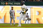 Pittsburgh Pirates' Anthony Alford (6) runs the bases in front of Washington Nationals second basemen Luis Garcia after hitting a solo home run during the seventh inning of a baseball game Friday, Sept. 10, 2021, in Pittsburgh. (AP Photo/Keith Srakocic)