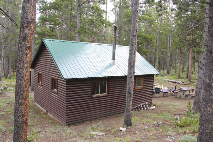 U.S. Forest Service cabins are popular places to rent for overnight stays in the backcountry including the Pole Creek Cabin, seen here on Aug. 14, 2021, in northern Wyoming's Bighorn National Forest. (Stephen Dow/Sheridan Press via AP)