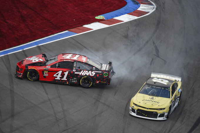 Daniel Suarez (41) spins in Turn 16 during a NASCAR Cup Series auto race at Charlotte Motor Speedway, Sunday, Sept. 29, 2019, in Concord, N.C. (AP Photo/Mike McCarn)