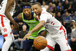 Toronto Raptors guard Norman Powell (24) and Minnesota Timberwolves forward Robert Covington (33) battle for the ball in the first quarter of an NBA basketball game Saturday, Jan. 18, 2020, in Minneapolis. (AP Photo/Andy Clayton-King)