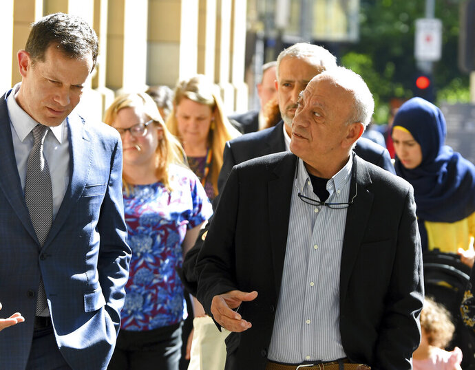 Saeed Maasarwe, right, the father of murdered exchange student, Aiia Maasarwe, arrives at the Supreme Court of Victoria in Melbourne, Australia, Tuesday, Oct. 29, 2019. A judge has sentenced Codey Herrmann to 36 years in prison for the murder and rape of Aiia Maasarwe, an Israeli student, in January. (James Ross/AAP Image via AP)