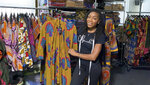 Iguehi James, an Oakland fashion entrepreneur, shows a kimono duster she designed for her apparel company Love Iguehi, Tuesday, Sept. 15, 2020, in Oaklnad, Calif. She received a $5,000 grant from the Oakland African American Chamber of Commerce's