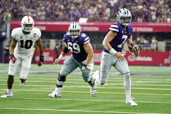 Stanford linebacker Jordan Fox (10) gives chase as Kansas State offensive lineman Noah Johnson watches quarterback Skylar Thompson (7) carry the ball for a touchdown in the second half of an NCAA college football game in Arlington, Texas, Saturday, Sept. 4, 2021. (AP Photo/Tony Gutierrez)