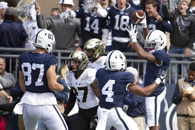 Penn State wide receiver KJ Hamler (1) celebrates his 23-yard touchdown pass in the first quarter of an NCAA college football game against Purdue in State College, Pa., on Saturday, Oct. 5, 2019. (AP Photo/Barry Reeger)
