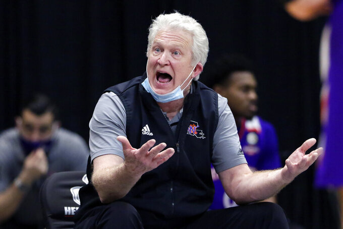 Northwestern State coach Mike McConathy reacts to a foul call during the first half of the team's NCAA college basketball game against Nicholls State in the Southland Conference men's tournament semifinals Friday, March 12, 2021, in Katy, Texas. (AP Photo/Michael Wyke)