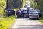 First responders work at the scene of the apprehension of a suspect at a residence in Bedias, Texas, Thursday, April 8, 2021, following a shooting at Kent Moore Cabinets in Bryan, Texas. One person was killed and several people were wounded Thursday in the wake of a shooting at the cabinet-making business in Bryan, authorities said, and a state trooper was later shot during a manhunt that resulted in the suspected shooter being taken into custody. (Michael Miller/College Station Eagle via AP)