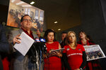 United Teachers Los Angeles union president Alex Caputo-Pearl, left, holds a news conference at the Los Angeles Unified School District headquarters in Los Angeles Friday, Jan. 11, 2019. A massive teachers strike in Los Angeles is still planned for Monday after a union rejected a new offer from the nation's second-largest school district and declared an impasse following 21 months of increasingly heated negotiations. (AP Photo/Damian Dovarganes)