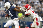 Penn State running back Journey Brown (4) stiff arms Rutgers defensive back Christian Izien (12) in the first quarter of an NCAA college football game in State College, Pa., on Saturday, Nov. 30, 2019. (AP Photo/Barry Reeger)