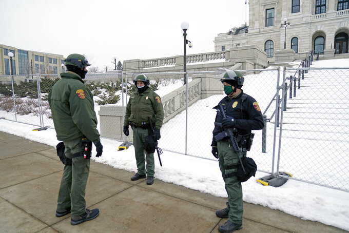 Minnesota Law Enforcement officers protect the Minnesota State Capitol Thursday, Jan. 7, 2021 in St. Paul, Minn., in the wake of the Electoral College protests Wednesday at the U.S. Capitol in Washington, D.C. (AP Photo/Jim Mone)