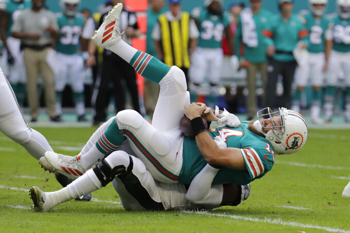 Philadelphia Eagles defensive end Josh Sweat (94) sacks Miami Dolphins quarterback Ryan Fitzpatrick (14), during the first half at an NFL football game, Sunday, Dec. 1, 2019, in Miami Gardens, Fla. (AP Photo/Lynne Sladky)