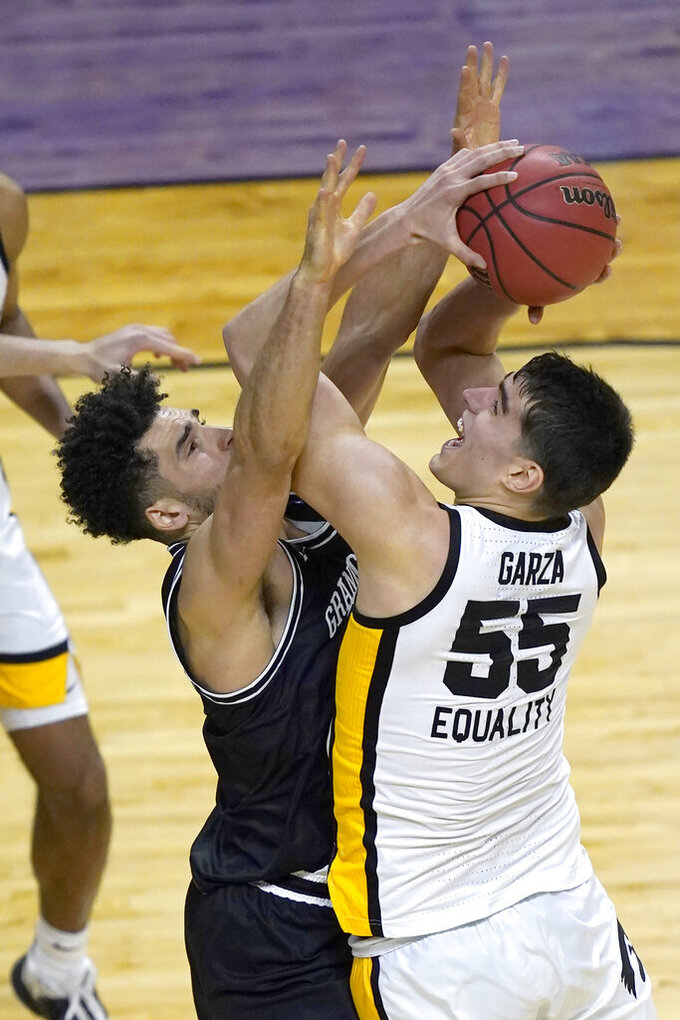 Iowa's Luka Garza (55) is pressured by Grand Canyon's Gabe McGlothan during the second half of a first round NCAA college basketball tournament game Saturday, March 20, 2021, at the Indiana Farmers Coliseum in Indianapolis. Iowa won 86-74. (AP Photo/Charles Rex Arbogast)