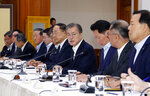 South Korean President Moon Jae-in, fourth from right, speaks during a meeting with business leaders at the presidential Blue House in Seoul, South Korea, Wednesday, July 10, 2019. Moon criticized comments by Japanese officials who questioned the credibility of Seoul's sanctions against North Korea while justifying Tokyo's move to strengthen controls on high-tech exports to South Korea, which triggered a full-blown diplomatic dispute between the neighboring U.S. allies. (Bae Jae-man/Yonhap via AP)
