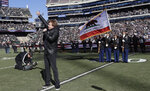FILE - In this Dec. 24, 2016 file photo, Eddie Money performs the national anthem before an NFL football game between the Oakland Raiders and the Indianapolis Colts in Oakland, Calif.   Money, the husky-voiced, blue collar rock star known for such hits as