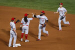 Cincinnati Reds celebrate a 3-0 win over the Chicago Cubs in a baseball game Wednesday, Sept. 9, 2020, in Chicago. (AP Photo/Kamil Krzaczynski)