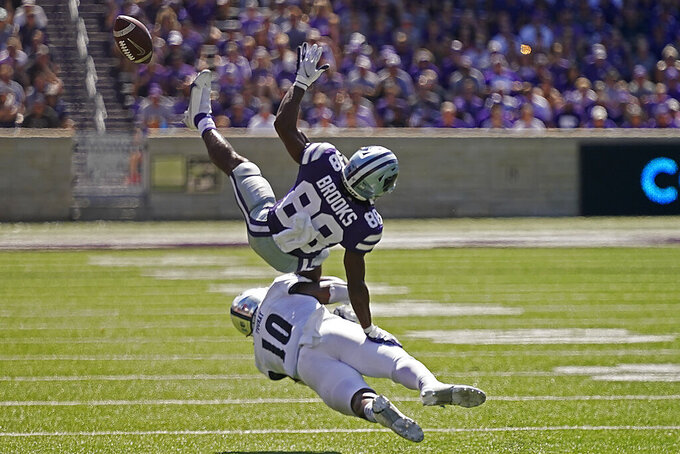 Nevada linebacker Lamin Touray (10) breaks up a pass intended for Kansas State wide receiver Phillip Brooks (88) during the first half of an NCAA college football game Saturday, Sept. 18, 2021, in Manhattan, Kan. (AP Photo/Charlie Riedel)