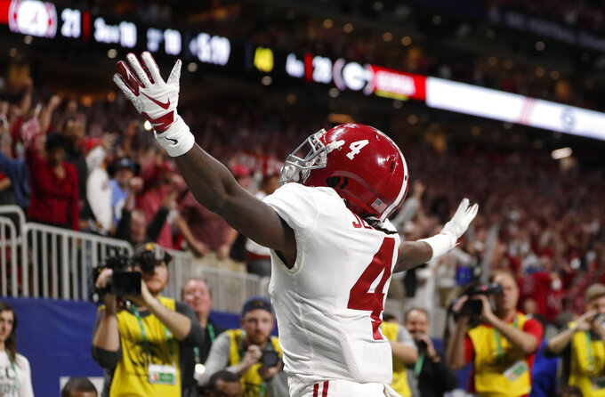 FILE - In this Dec. 1, 2018, file photo, Alabama wide receiver Jerry Jeudy (4) celebrates his touchdown catch against Georgia during the second half of the Southeastern Conference championship NCAA college football game, in Atlanta. Jeudy's ambitions grew with every college football camp he attended, every highly rated defensive back he beat head to head. His recruiting stock rose, and so did his goals. Now, he's Alabama's latest star wide receiver and a Biletnikoff Award winner heading into the College Football Playoffs. (AP Photo/John Bazemore, File)
