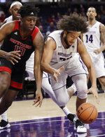 Northwestern center Barret Benson, right, battles for a loose ball against Rutgers forward Shaq Carter during the first half of an NCAA college basketball game, Wednesday, Feb. 13, 2019, in Evanston, Ill. (AP Photo/Nam Y. Huh)