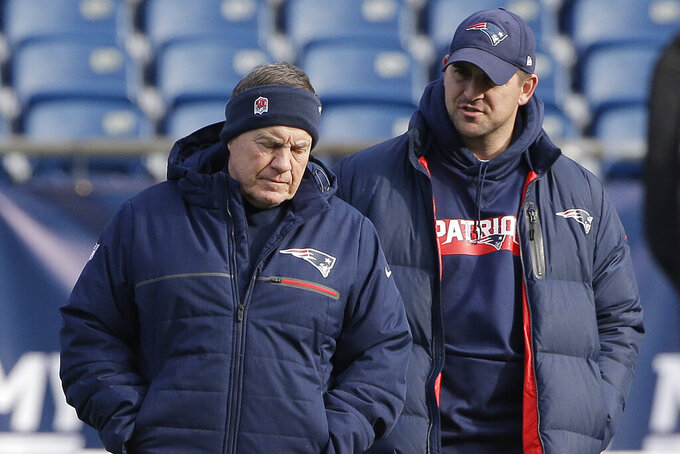 FILE - In this Dec. 20, 2018, file photo, New England Patriots head coach Bill Belichick, left, speaks with special teams coach Joe Judge, right, during NFL football practice in Foxborough, Mass. The New York Giants and Patriots assistant Joe Judge are working on a deal for him to become the team's head coach, a person familiar with the negotiations told The Associated Press The person spoke to the on condition of anonymity Tuesday, Jan. 7, 2020, because the deal is not done. (AP Photo/Steven Senne)