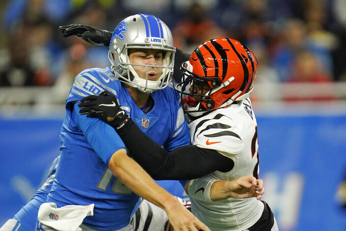 Detroit Lions quarterback Jared Goff (16) is pressured by Cincinnati Bengals safety Vonn Bell during the first half of an NFL football game, Sunday, Oct. 17, 2021, in Detroit. (AP Photo/Paul Sancya)