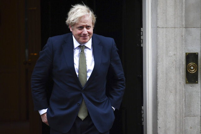 Britain's Prime Minister Boris Johnson steps outside 10 Downing Street, in London, to welcome Egypt's President Abdel Fattah el-Sisi on Tuesday, Jan. 21, 2020. (AP Photo/Alberto Pezzali)