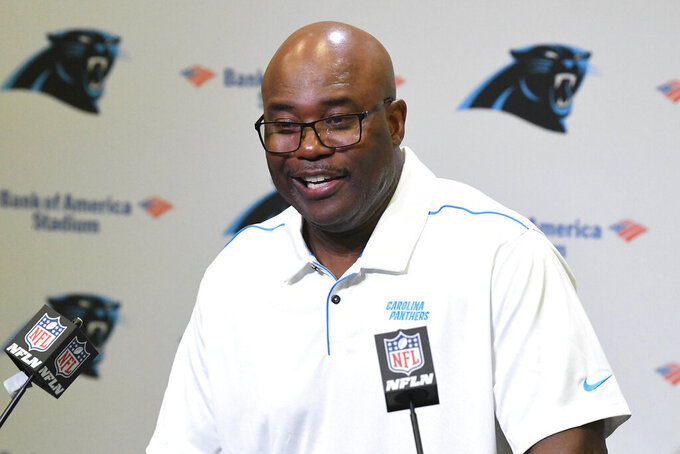 Carolina Panthers' Perry Fewell laughs as he answers a question during his first press conference as the NFL football team's interim head coach, at Bank of America Stadium in Charlotte, N.C., Wednesday, Dec. 4, 2019. Ron Rivera was fired as head coach on Tuesday. (David T. Foster III/The Charlotte Observer via AP)
