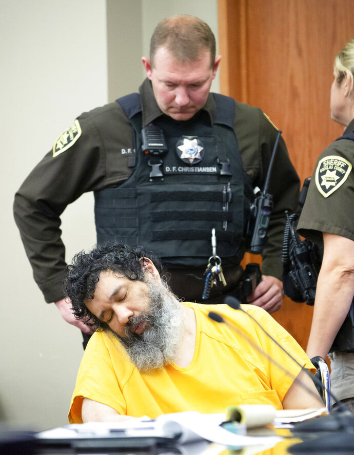 Anthony Garcia appears unresponsive at the Douglas County Court in Omaha, Neb., Friday, Sept. 14, 2018. Garcia, a former doctor, was convicted in the revenge killings of four people connected to a Nebraska medical school and has been sentenced to death by a three-judge panel. Garcia was convicted in two attacks that occurred five years apart. The first victims were the son and housekeeper of a faculty member at Creighton University School of Medicine in Omaha. Garcia also was found guilty in the 2013 deaths of another Creighton pathology doctor and his wife. (Kent Sievers/Omaha World-Herald via AP, Pool)