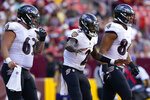 Baltimore Ravens quarterback Tyler Huntley (2) celebrates his touchdown run with teammates Trystan Colon-Castillo (63) and Josh Oliver (84) during the first half of a preseason NFL football game against the Washington Football Team, Saturday, Aug. 28, 2021, in Landover, Md. (AP Photo/Carolyn Kaster)