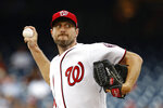 """FILE - In this July 25, 2019, file photo, Washington Nationals starting pitcher Max Scherzer throws to the Colorado Rockies during a baseball game in Washington. Three-time Cy Young Award winner Max Scherzer says he is """"ready to get in a game"""" for the Washington Nationals and come off the injured list. Scherzer played catch at Nationals Park on Wednesday, Aug. 14. a day after throwing the equivalent of about two innings in a simulated game, and said he felt able to return to action from a back muscle problem. (AP Photo/Patrick Semansky, File)"""