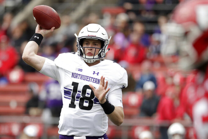 Northwestern quarterback Clayton Thorson throws a pass against Rutgers during the first half of an NCAA college football game, Saturday, Oct. 20, 2018, in Piscataway, N.J. (AP Photo/Julio Cortez)