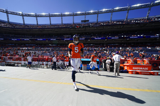 Denver Broncos quarterback Joe Flacco walks onto the field before an NFL football game against the Jacksonville Jaguars, Sunday, Sept. 29, 2019, in Denver. (AP Photo/Jack Dempsey)