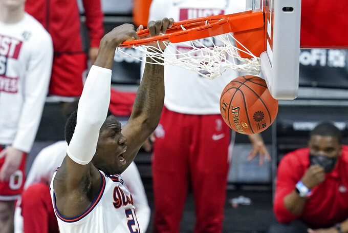 Illinois's Kofi Cockburn dunks during the first half of an NCAA college basketball game against Ohio State at the Big Ten Conference championship, Sunday, March 14, 2021, in Indianapolis. (AP Photo/Darron Cummings)