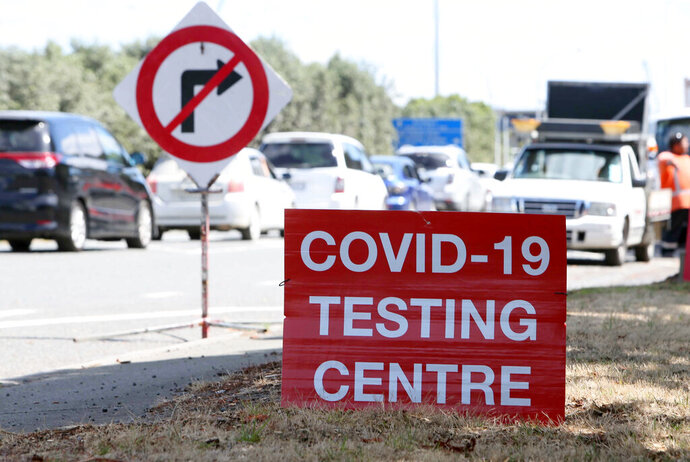 Signs direct drivers waiting for a COVID-19 testing at a pop-up testing centre at Marsden Point, New Zealand, on Monday, Jan. 25, 2021. Health officials in New Zealand say genome tests indicate the country's most recent COVID-19 patient contracted the virus from another returning traveler just before leaving quarantine. (Tania Whyte/Northern Adivacate/NZME via AP)