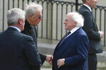 Irish President Michael D Higgins, right, arrives for the funeral service for journalist Lyra McKee at St Anne's Cathedral in Belfast, northern Ireland, Wednesday April 24, 2019. The leaders of Britain and Ireland will join hundreds of mourners Wednesday at the funeral of Lyra McKee, the young journalist shot dead during rioting in Northern Ireland last week. (Liam McBurney/PA via AP)