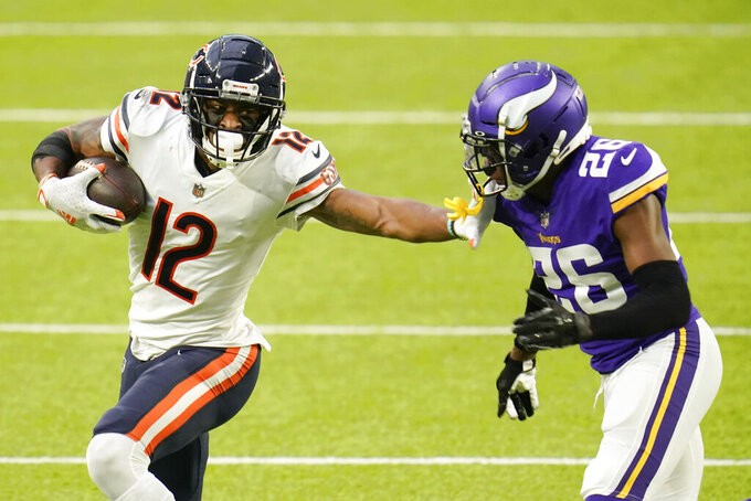 Chicago Bears wide receiver Allen Robinson II (12) runs from Minnesota Vikings cornerback Chris Jones (26) after catching a pass during the second half of an NFL football game, Sunday, Dec. 20, 2020, in Minneapolis. (AP Photo/Jim Mone)