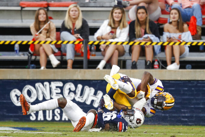 LSU wide receiver Kayshon Boutte catches a pass for a touchdown as he rolls into the end zone over Auburn defensive back Jaylin Simpson (36) during the second half of an NCAA college football game Saturday, Oct. 31, 2020, in Auburn, Ala. (AP Photo/Butch Dill)