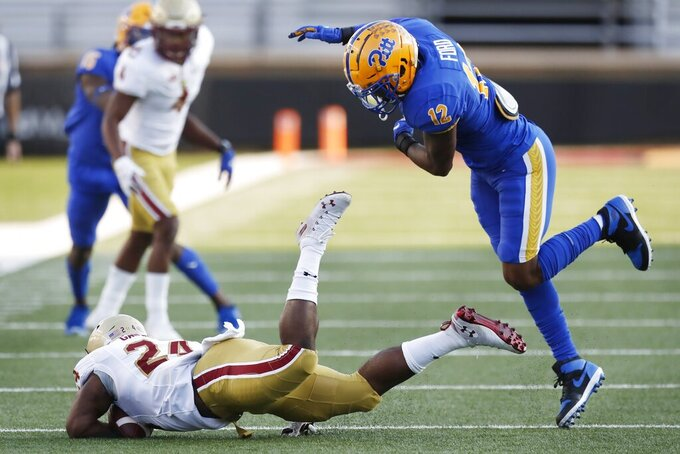 Pittsburgh defensive back Paris Ford (12) throws Boston College running back Pat Garwo III (24) to the ground during the first half of an NCAA college football game, Saturday, Oct. 10, 2020, in Boston. (AP Photo/Michael Dwyer)