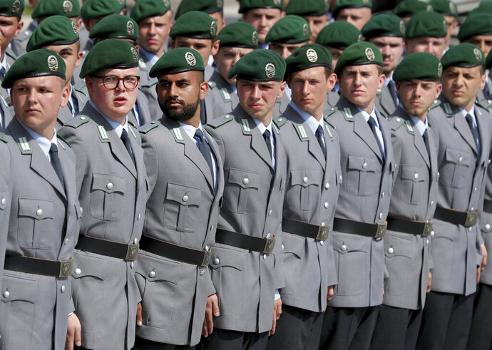 In this Saturday, July 20, 2019 photo soldiers attend an oath-taking ceremony of the German army at the Defence Ministry in Berlin, Germany. After 100 years, the German army will get military rabbis again. Chancellor Angela Merkel's Cabinet unanimously passed a ruling on Wednesday to reinstall Jewish religious counseling in the army. (AP Photo/Michael Sohn)