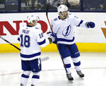 Tampa Bay Lightning defenseman Brayden Point, right, celebrates a goal against the Columbus Blue Jackets with teammate forward Ondrej Palat, of the Czech Republic, during the third period of an NHL hockey game in Columbus, Ohio, Monday, Feb. 18, 2019. Tampa Bay won 5-1. (AP Photo/Paul Vernon)