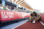 Allyson Felix celebrates after her second place finish in the women's 400-meter run with her daughter Camryn at the U.S. Olympic Track and Field Trials Sunday, June 20, 2021, in Eugene, Ore. (AP Photo/Ashley Landis)