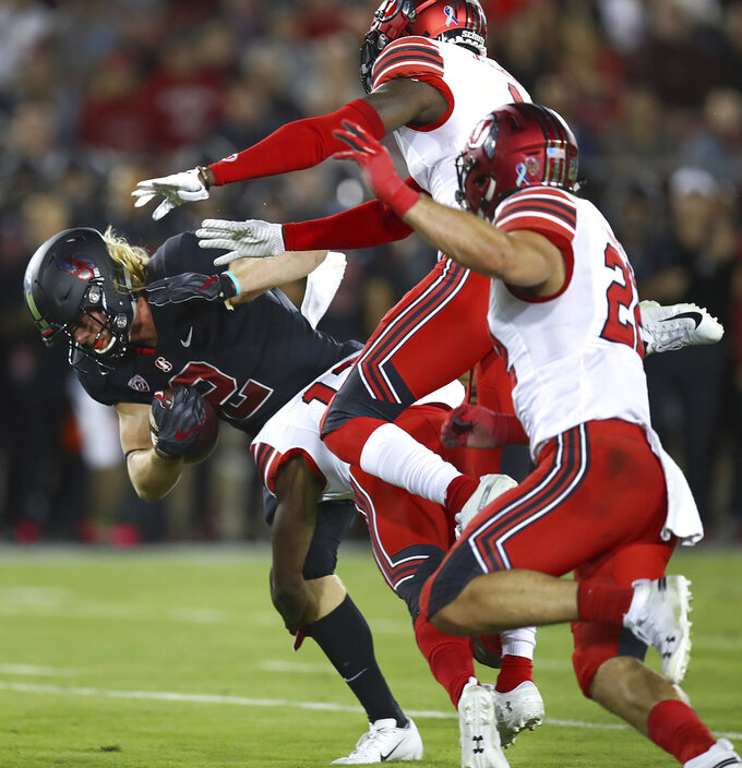 Stanford's Trenton Irwin, left, runs against Utah's Chase Hansen (22) and another defender during the first half of an NCAA college football game Saturday, Oct. 6, 2018, in Stanford, Calif. (AP Photo/Ben Margot)