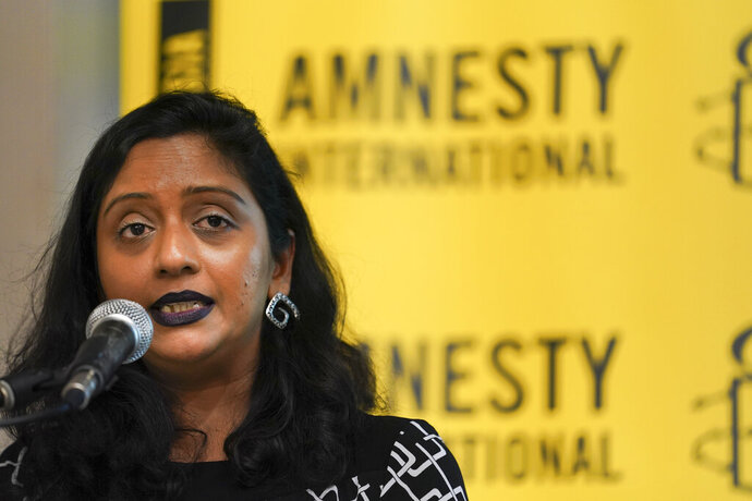Shamini Darshni Kalimuthu, Executive Director of Amnesty International Malaysia, seeks during a press conference in Petaling Jaya, Malaysia, Thursday, Oct. 10, 2019. Amnesty International has urged Malaysia to abolish the death penalty, saying unfair trials and the use of harsh treatment to obtain confessions put people at risk of execution. (AP Photo/Vincent Thian)