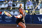 Craotia's Petra Martic returns the ball to Russia's Ludmilla Samsonova, during Palermo Ladies Open tennis tournament in Palermo, Italy, Thursday, Aug. 6, 2020. Tour-level tennis resumed after a five-month enforced break and players at the Palermo Ladies Open had to handle their own towels and not shake hands of opponents. The strict rules because of the coronavirus included no showers on site, and no autographs or photos with fans. Players in the singles main draw come from 15 countries, all in Europe. (Palermo Ladies Open via AP)