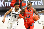 Auburn's Jaylin Williams (23) drives to the basket against Central Florida guard Darin Green Jr. (22) during the second half of an NCAA college basketball game, Monday, Nov. 30, 2020, in Orlando, Fla. (AP Photo/John Raoux)