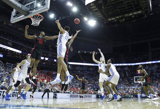Houston's Brison Gresham (55) and Kentucky's PJ Washington (25) reach for a rebound during the first half of a men's NCAA tournament college basketball Midwest Regional semifinal game Friday, March 29, 2019, in Kansas City, Mo. (AP Photo/Charlie Riedel)