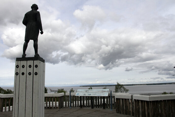 The Captain James Cook statue facing the inlet that bears his name and fronts Alaska's largest city in downtown Anchorage, Alaska is seen on June 23, 2020. Far away from Confederate memorials, Alaska residents have joined the movement to eliminate statues of colonialists accused of abusing and exploiting Indigenous people. The effort has already resulted in a statue of Russian America colonialist Alexander Baranov being taken out of public view in one city. Others want statutes removed of U.S. Secretary of State and Alaska purchase architect William Seward and Capt. James Cook. (AP Photo/Mark Thiessen)