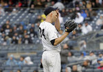 New York Yankees starting pitcher J.A. Happ reacts after giving up a three-run home run during the first inning of a baseball game against the Baltimore Orioles at Yankee Stadium, Sunday, March 31, 2019, in New York. (AP Photo/Seth Wenig)