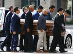 Pallbearers carry the casket of former Democratic U.S. Rep. Ed Pastor into St. Francis Xavier Catholic Church for his funeral Friday, Dec. 7, 2018, in Phoenix. Pastor was Arizona's first Hispanic member of Congress, spending 23 years in Congress before retiring in 2014. He passed away last week at the age of 75. (AP Photo/Ross D. Franklin)