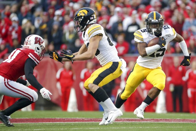 Iowa's Tyler Goodson runs during the first half of an NCAA college football game against Wisconsin Saturday, Nov. 9, 2019, in Madison, Wis. (AP Photo/Morry Gash)